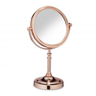 Espejo de maquillaje con cara de aumento